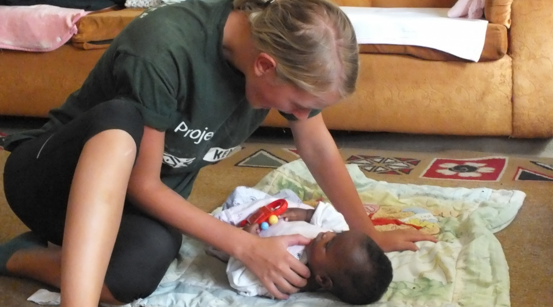 An undergraduate student in Kenya working at an Occupational Therapy placement abroad.